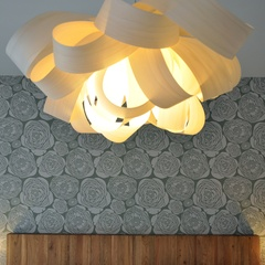 pendant lamp in front of floral wallpaper